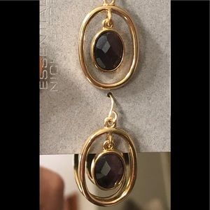 Golden tone earrings with stone